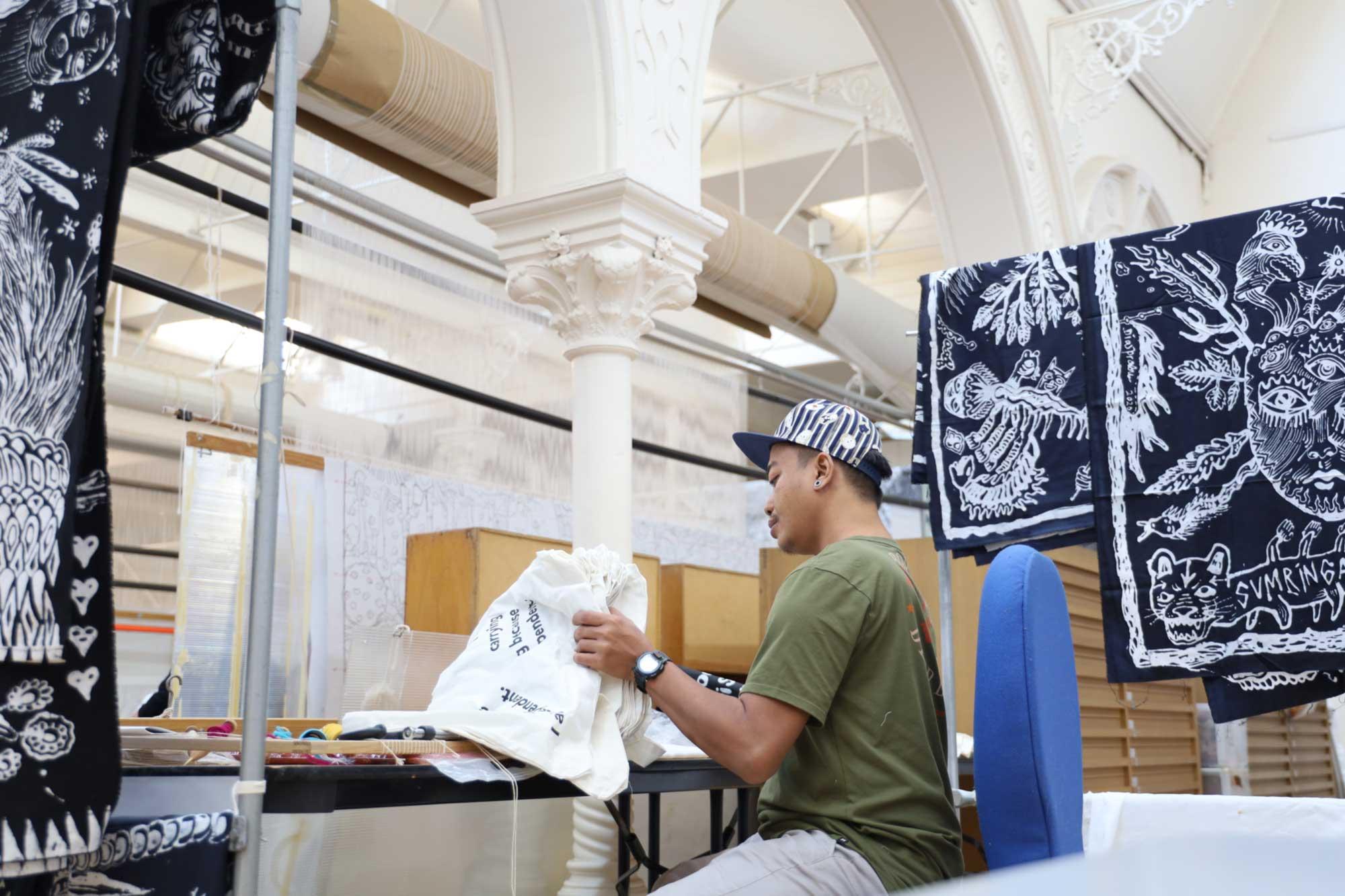 Dias Prabu working at the ATW. Photo: Dewie Bukit.