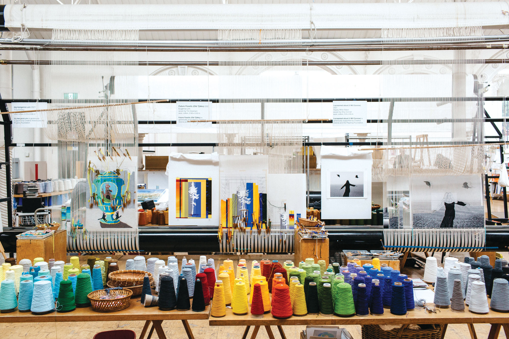'Weaving Futures' tapestries designed by Troy Emery, Eugenia Lim and Hayley Millar Baker on the looms at ATW. Image: Marie-Luise Skibbe.