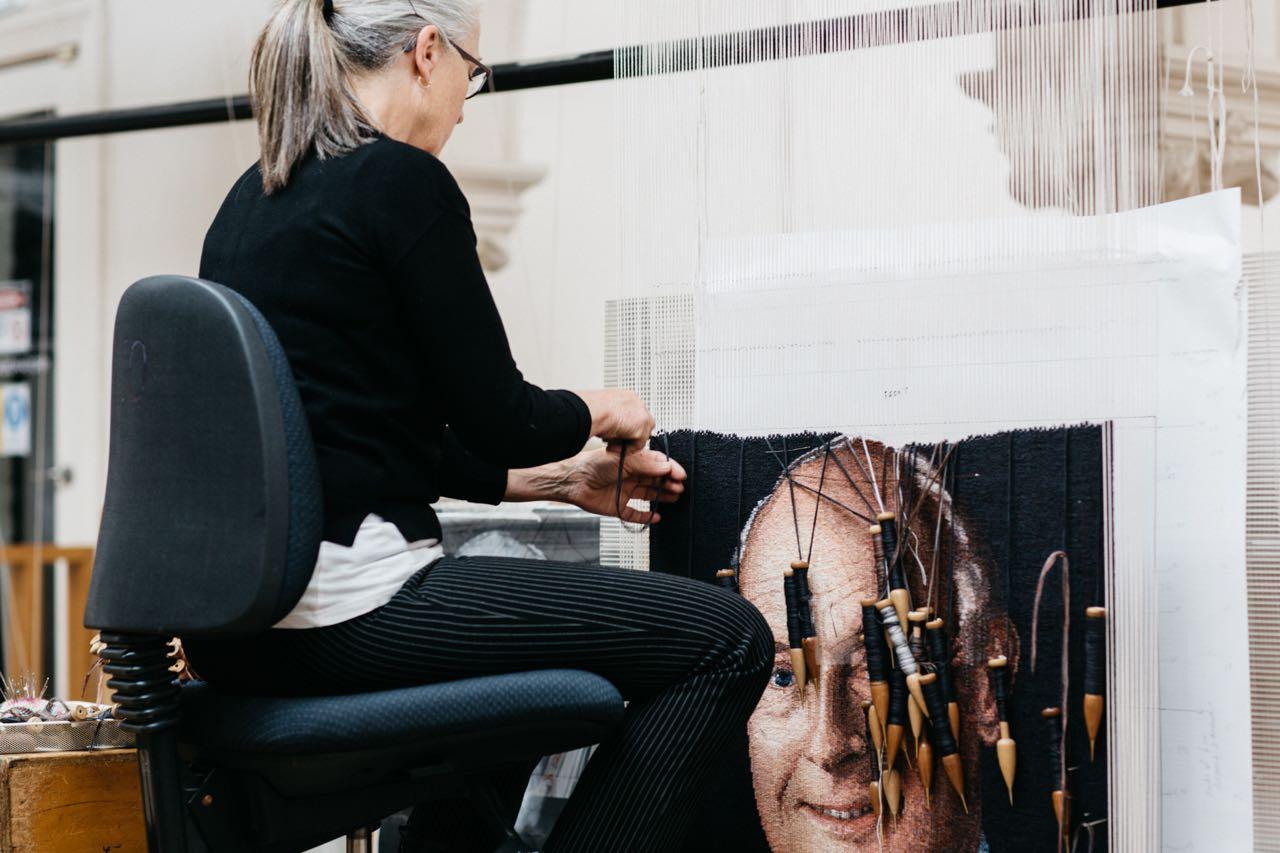 ATW weaver Pamela Joyce working on portrait of John B Reid AO, 2019. Photo by Marie-Luise Skibbe.