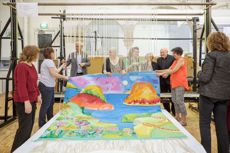 Cutting Off Ceremony for 'Point Addis,' 2013, designed by Angela Brennan, woven by Sue Batten, Chris Cochius & Milena Paplinska, wool and cotton, 1.80 x 2.00m. Photograph: Jeremy Weihrauch.
