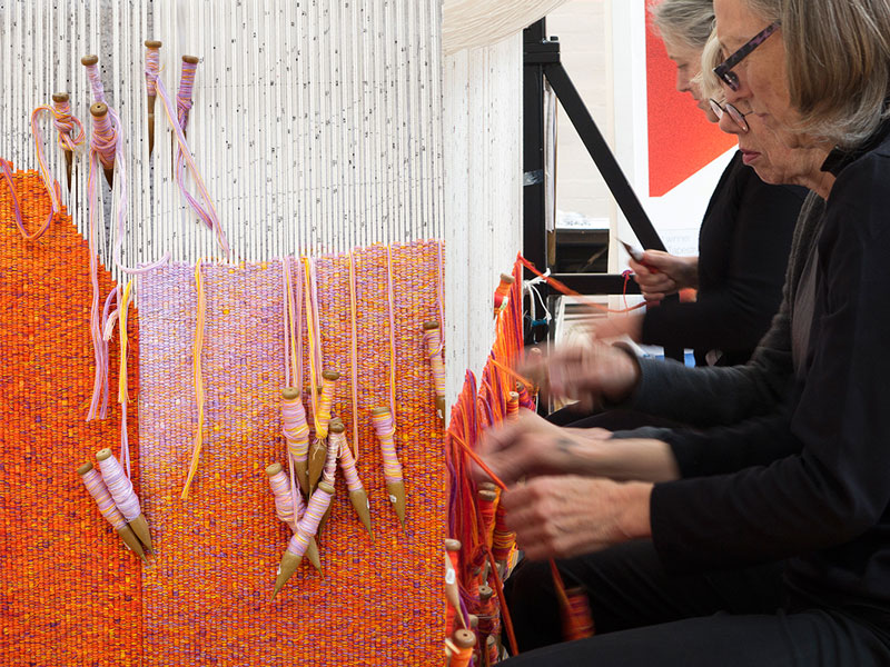 Left: Detail: 'Perspectives on a Flat Surface,' 2016, John Wardle Architects. Photograph: ATW. Right: ATW weavers working on 'Perspectives on a Flat Surface,' 2016, John Wardle Architects. Photograph: ATW.