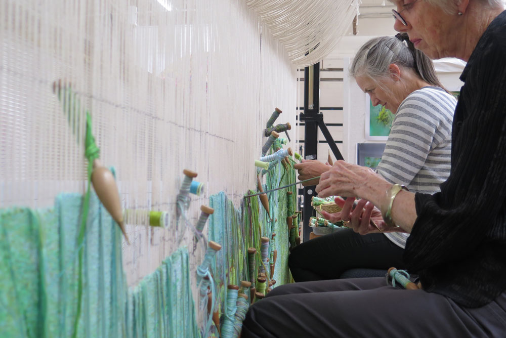 ATW weavers working on 'Listen, to the Sound of Plants' 2017, designed by Janet Laurence and woven by Chris Cochius, Pamela Joyce & Cheryl Thornton, wool and cotton, 1.2 x 2.4m. Photo: ATW.