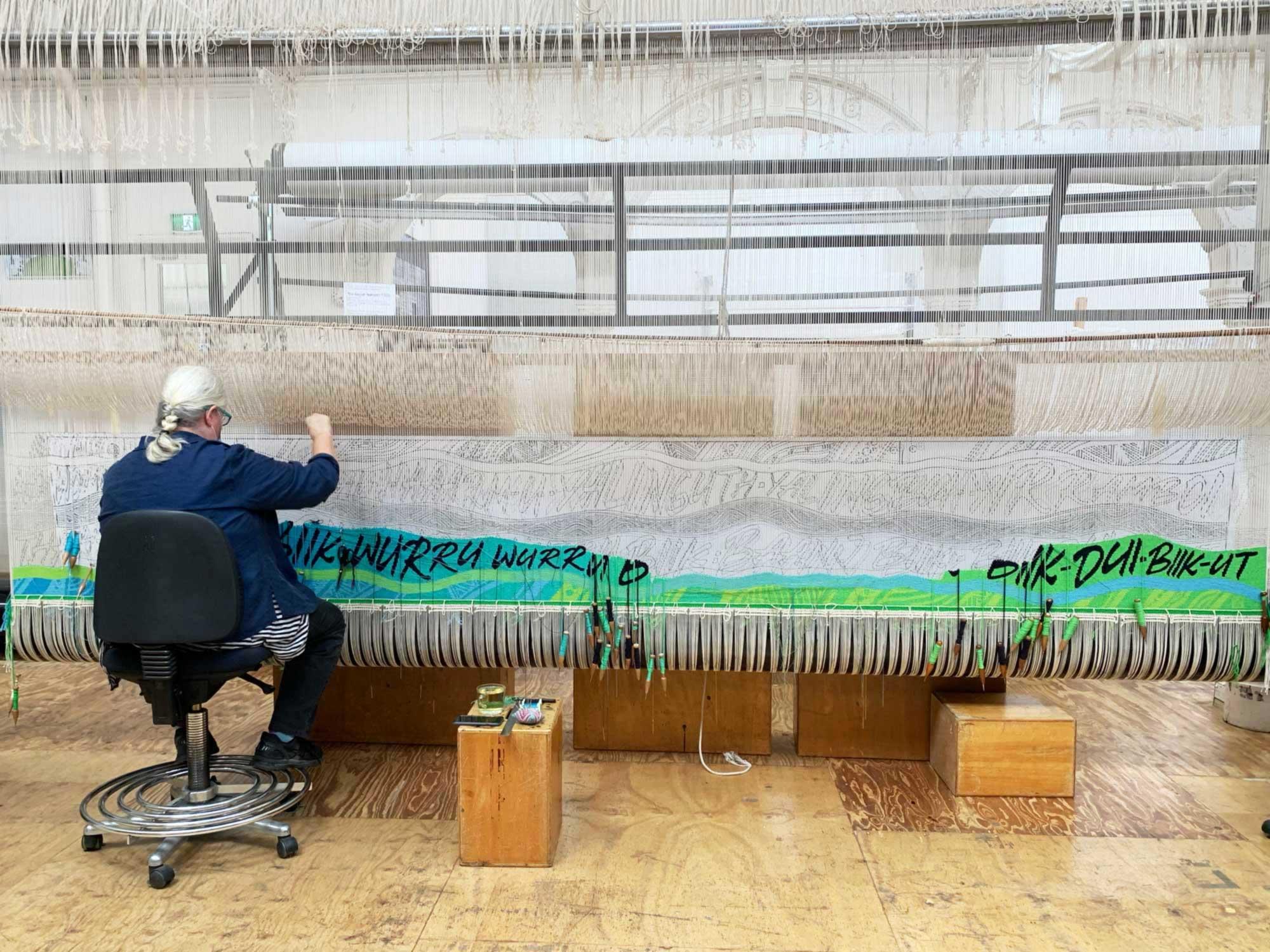 Tapestry in progress: Chris Cochius weaves the 'Wurundjeri Biik, yalinguth, yalingbu, yirramboi' tapestry designed by Mandy Nicholson. Photo ATW.