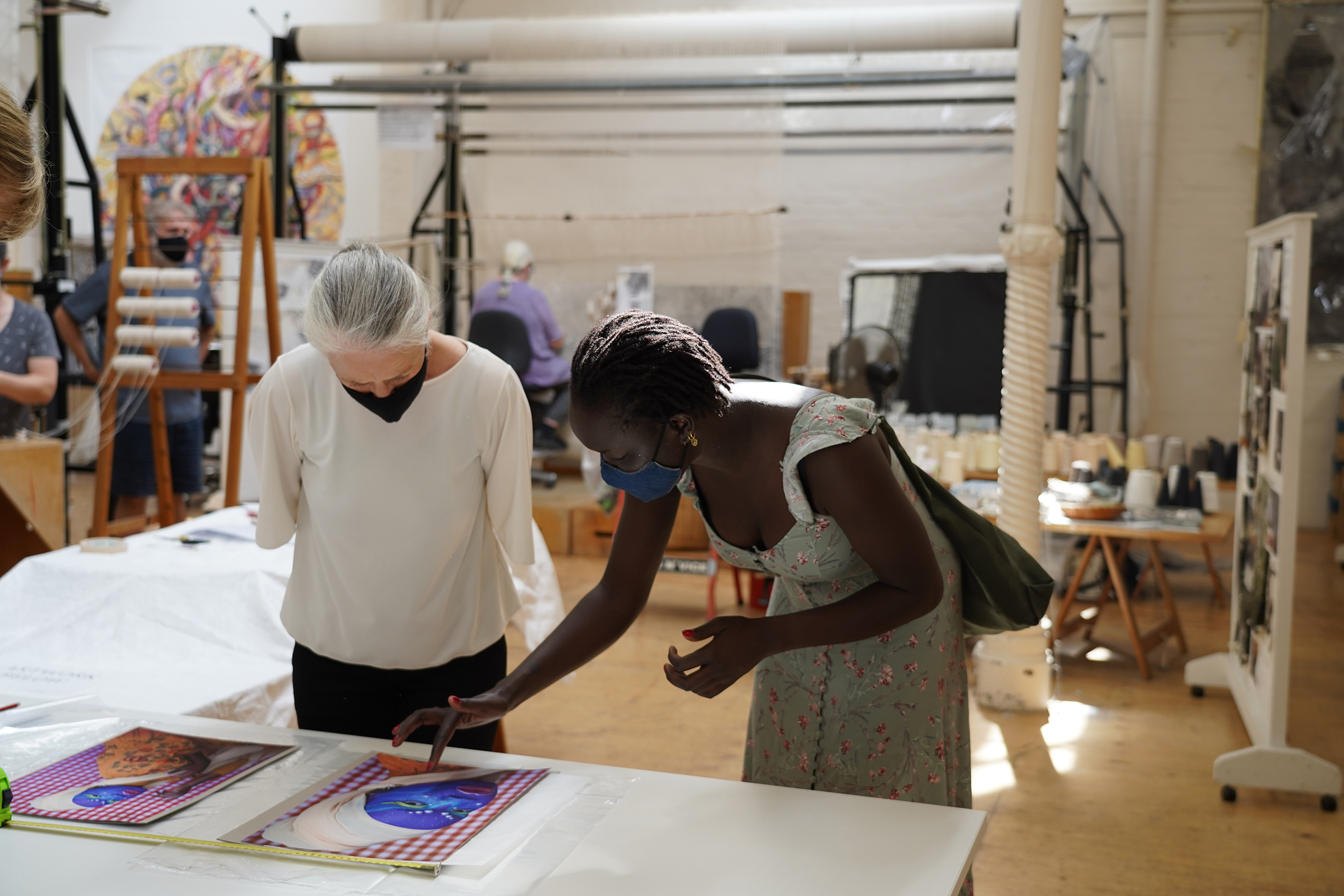 ATW weaver Pamela Joyce & artist Atong Atem discussing the 'Self Portrait in July (4)' tapestry design at the ATW, 2021. Image: ATW.