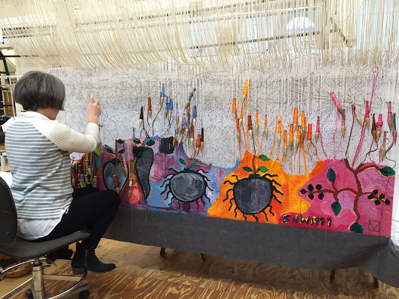 ATW weaver Pamela Joyce working on 'Gordian Knot' designed by Keith Tyson in 2016 and woven by Chris Cochius, Pamela Joyce and Cheryl Thornton. Photograph: ATW.
