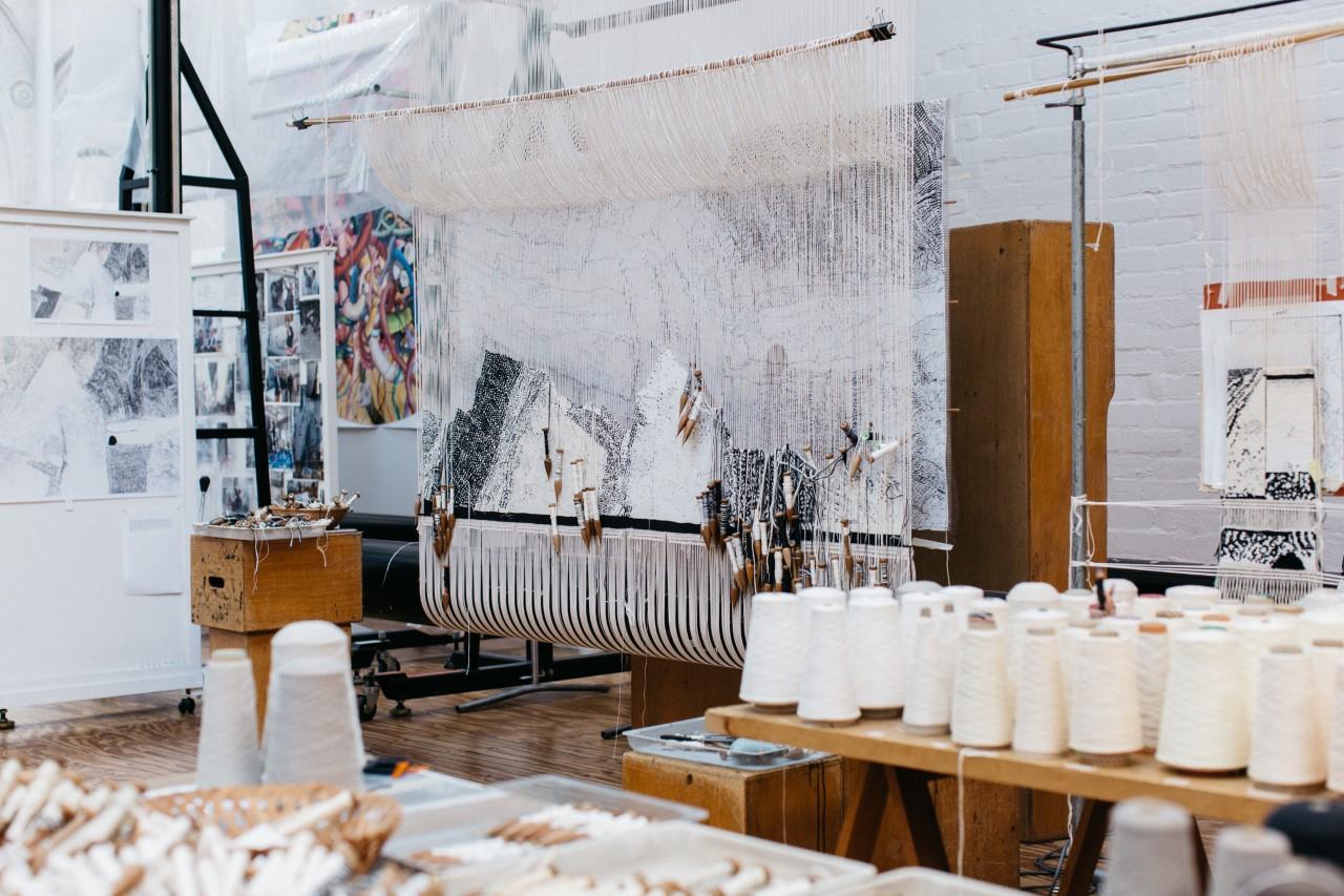 In progress: 'Ilpili', 2021, designed by Pepai Jangala Carroll, woven by Pamela Joyce, Chris Cochius & Cheryl Thornton, 1.2 x 1.9 m, wool and cotton. Photo: Marie-Luise Skibbe.